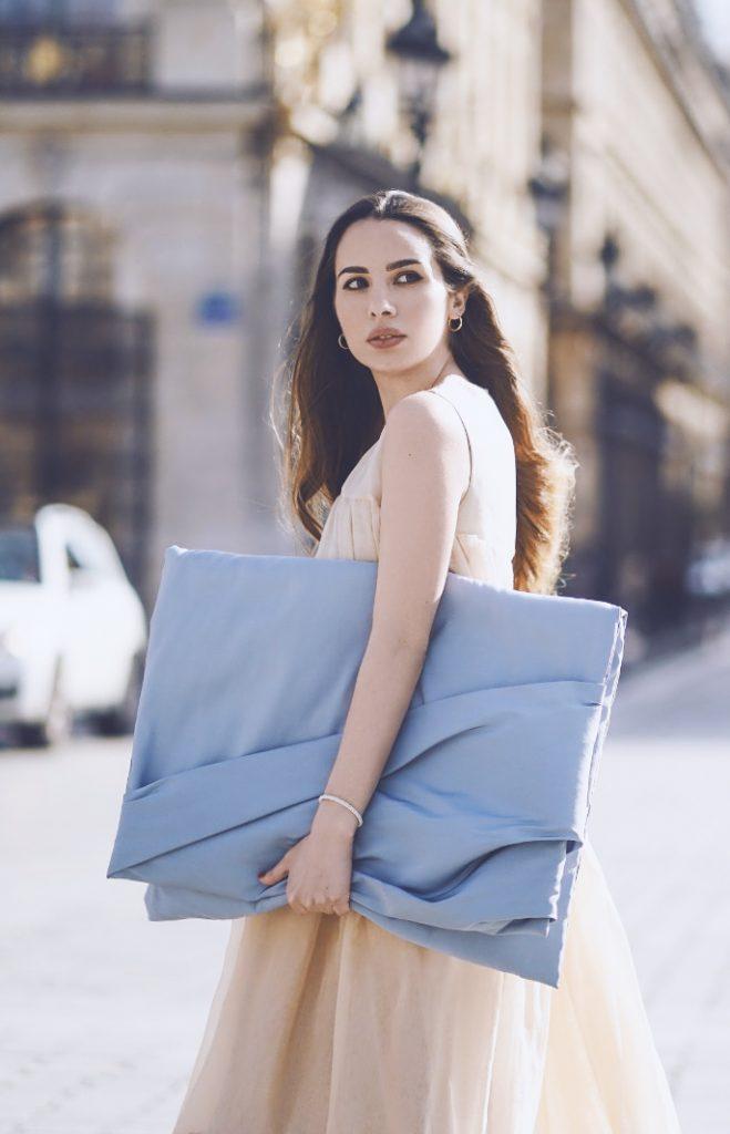 Maria Rosaria Rizzo wears the Natan oversize clutch